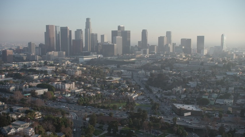 5K stock footage aerial video of Downtown Los Angeles skyline and city sprawl, California Aerial Stock Footage | AX64_0082