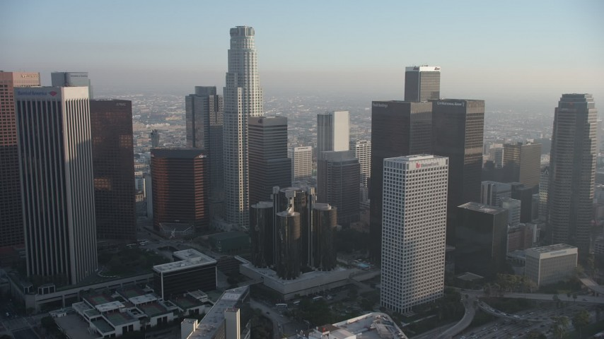 5K stock footage aerial video approach US Bank Tower and Westin Bonaventure Hotel in Downtown Los Angeles, California Aerial Stock Footage | AX64_0086