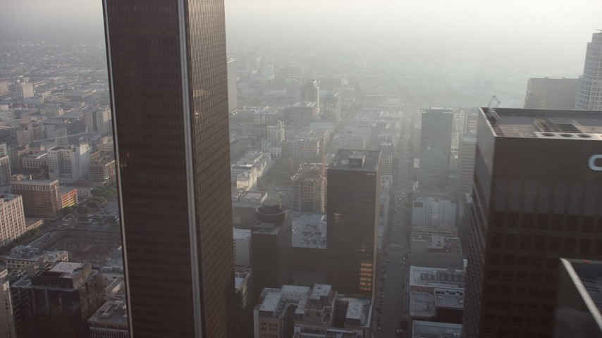5K stock footage aerial video flyby Downtown Los Angeles skyscrapers in haze, California Aerial Stock Footage | AX64_0088