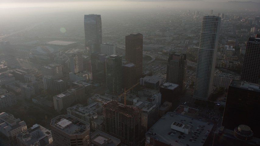 5K stock footage aerial video of haze-shrouded skyscrapers in Downtown Los Angeles, California Aerial Stock Footage | AX64_0089