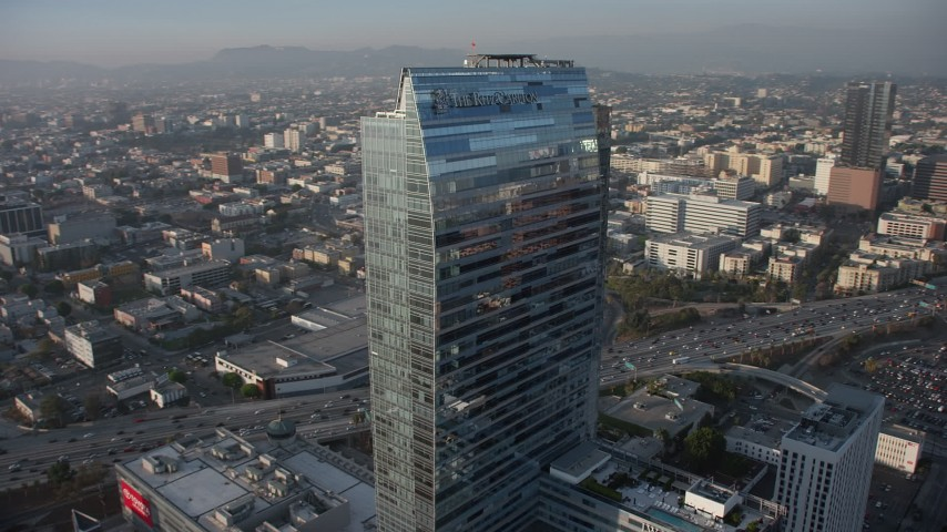 5K aerial video of the Ritz-Carlton hotel, reveal Downtown Los Angeles skyscrapers, California Aerial Stock Footage | AX64_0091