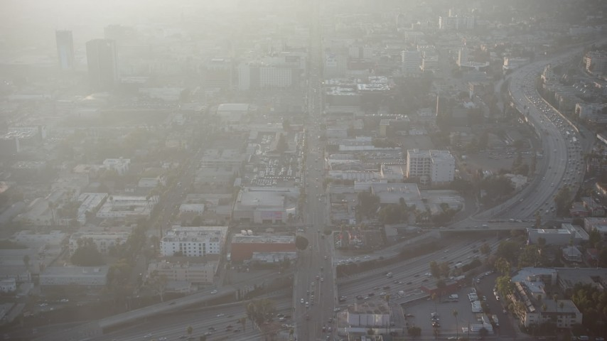 5K stock footage aerial video follow Hollywood Boulevard in Los Angeles, California, sunset Aerial Stock Footage | AX64_0115