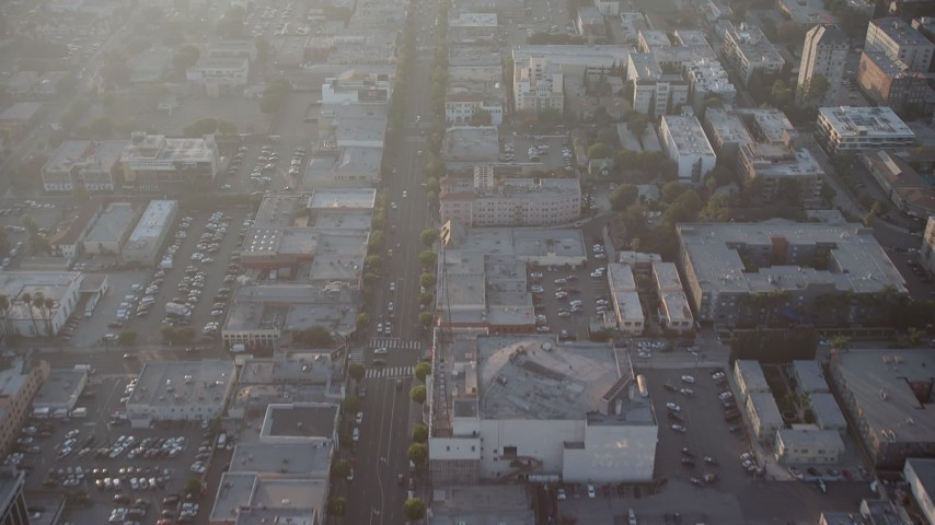 5K stock footage aerial video of cars on Hollywood Boulevard through Hollywood, California, Sunset Aerial Stock Footage | AX64_0117