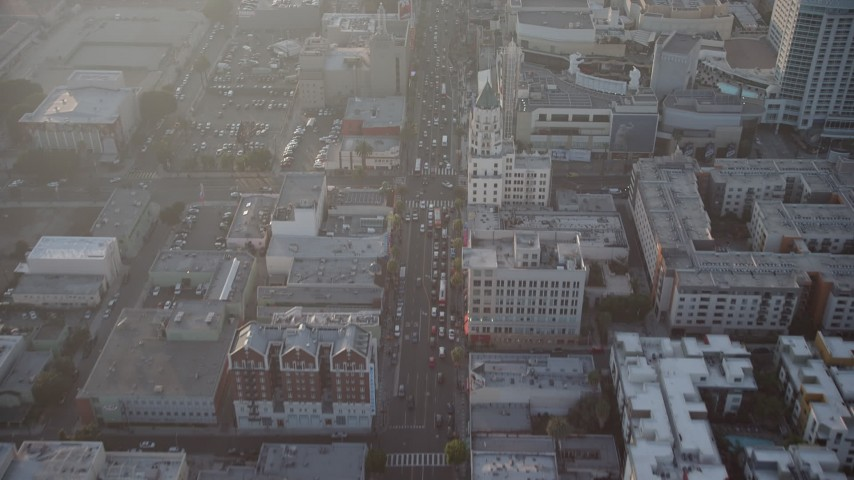 5K stock footage aerial video of malls and theaters on Hollywood Boulevard, Hollywood, California, Sunset Aerial Stock Footage | AX64_0118