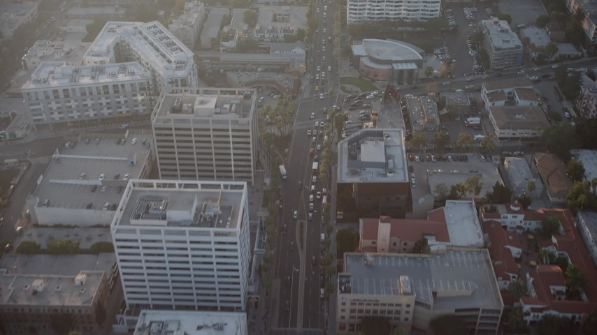 5K stock footage aerial video of apartment and office buildings on Hollywood Boulevard, Hollywood, California, sunset Aerial Stock Footage | AX64_0119
