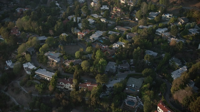 5K stock footage aerial video fly over hillside homes in Hollywood Hills, California, sunset Aerial Stock Footage | AX64_0124