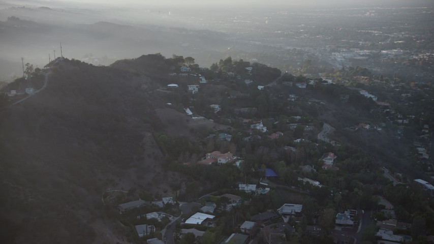 5K stock footage aerial video flyby luxury homes in the Hollywood Hills, California, sunset Aerial Stock Footage | AX64_0125