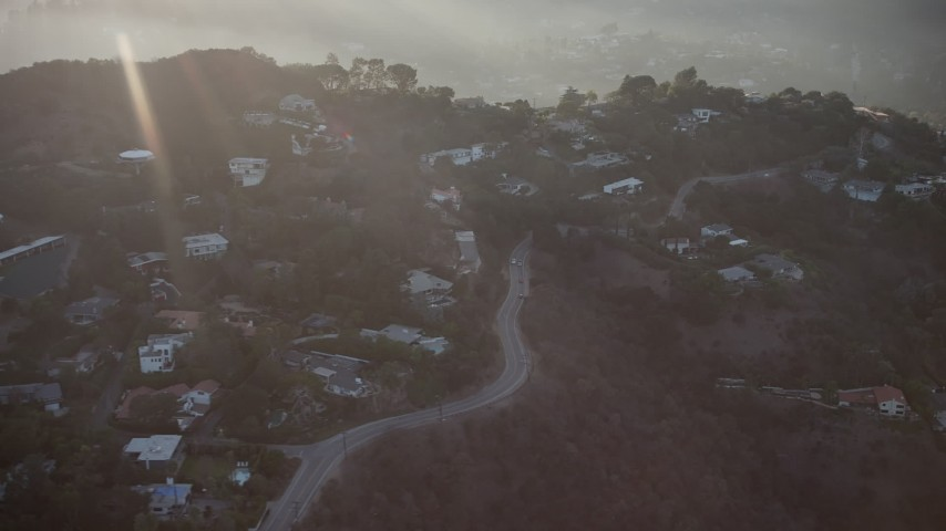 5K stock footage aerial video of passing homes on a hillside in Hollywood Hills, California, sunset Aerial Stock Footage | AX64_0126