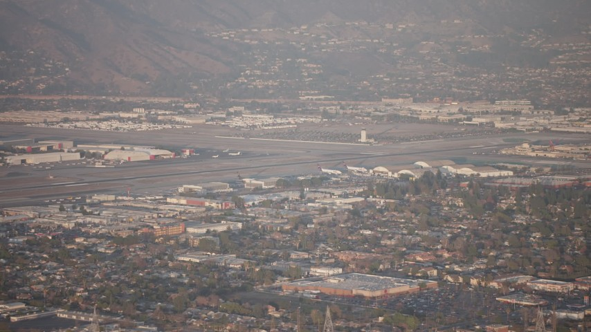 5K stock footage aerial video of Bob Hope International Airport in Burbank, California, sunset Aerial Stock Footage | AX64_0131