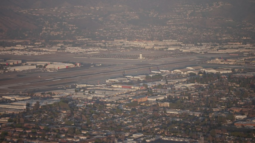 5K stock footage aerial video flyby Bob Hope International Airport, Burbank, California, sunset Aerial Stock Footage | AX64_0132