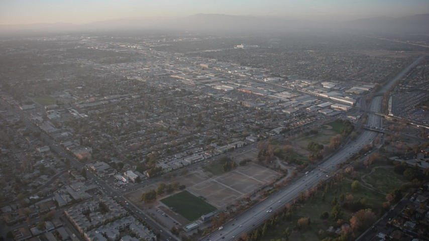 5K stock footage aerial video of Highway 170 and Sherman Way Square mall in North Hollywood, California, sunset Aerial Stock Footage | AX64_0133