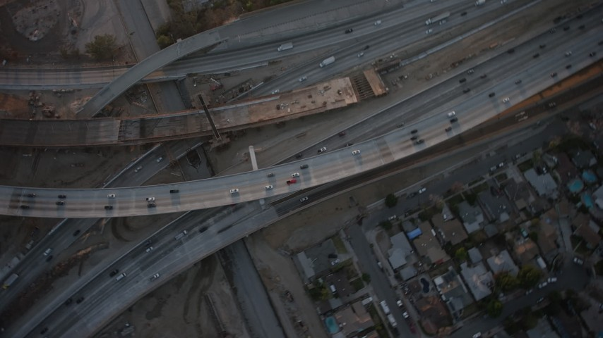 5K stock footage aerial video of bird's eye of Interstate 5 and Highway 170, Sun Valley, California, sunset Aerial Stock Footage | AX64_0137