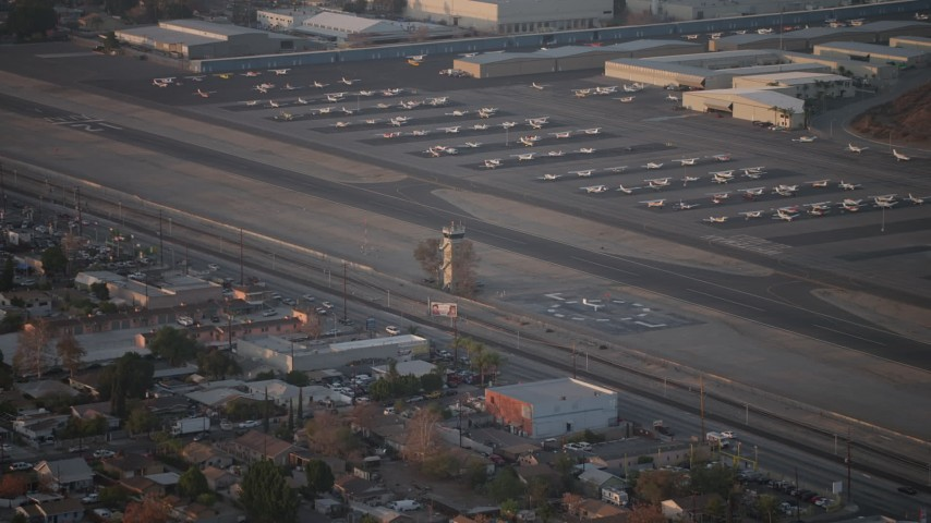5K stock footage aerial video of airport control tower at Whiteman Airport, Pacoima California, sunset Aerial Stock Footage | AX64_0138