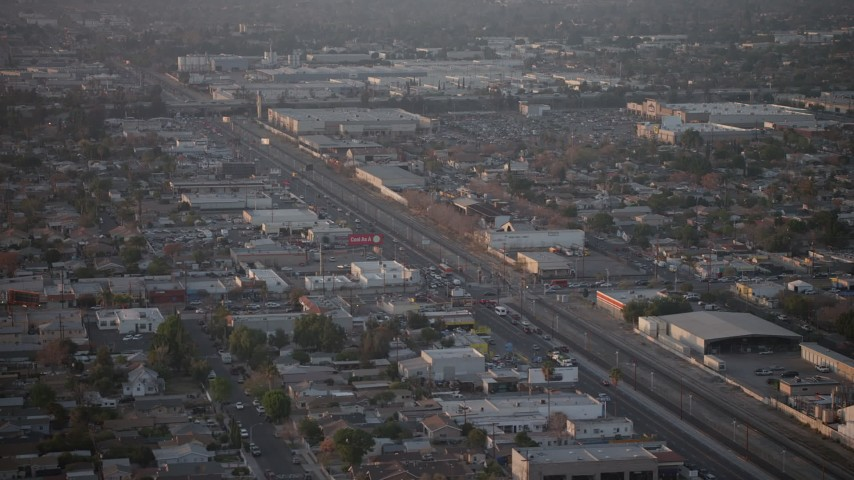 5K stock footage aerial video of San Fernando Road and warehouse buildings in Pacoima, California, Sunset Aerial Stock Footage | AX64_0140
