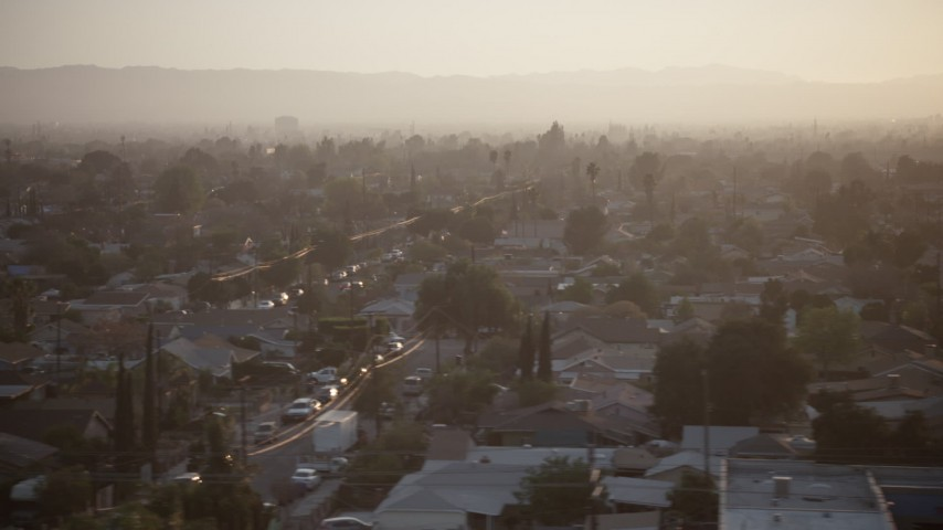 5K stock footage aerial video of urban neighborhoods in Pacoima, California, sunset Aerial Stock Footage | AX64_0141