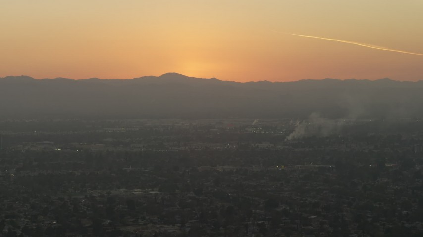 5K stock footage aerial video of suburban neighborhoods and mountains in Pacoima, California, sunset Aerial Stock Footage | AX64_0144