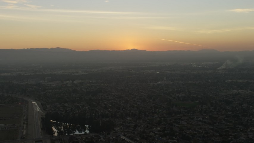 5K stock footage aerial video of suburban neighborhoods and distant mountains, Pacoima, California, sunset Aerial Stock Footage | AX64_0145