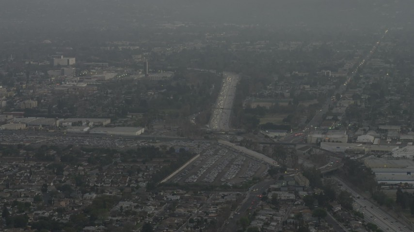 5K stock footage aerial video of Highway 170, suburban homes, and large parking lot, North Hollywood, California, sunset Aerial Stock Footage | AX64_0146