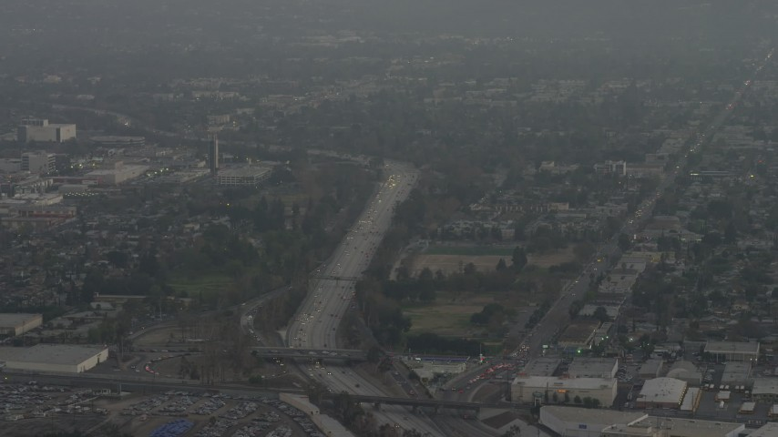 5K stock footage aerial video of light traffic on Highway 170 and suburban neighborhoods, North Hollywood, California, sunset Aerial Stock Footage | AX64_0147