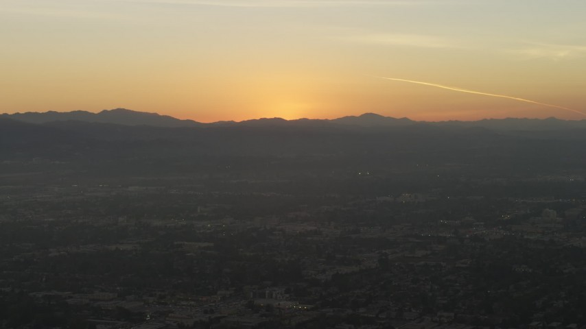 5K stock footage aerial video of the sun setting behind the Hollywood Hills in California, sunset Aerial Stock Footage | AX64_0148