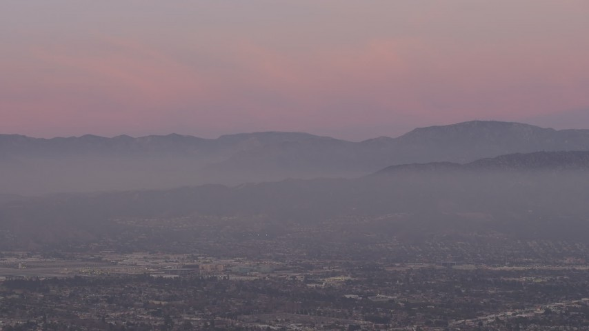 5K stock footage aerial video of San Gabriel Mountains from across the San Fernando Valley, Los Angeles, California, twilight Aerial Stock Footage | AX64_0159