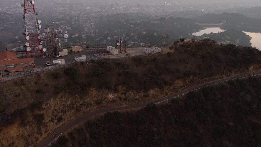 5K stock footage aerial video flyby the radio tower above Hollywood Sign, Los Angeles, California, twilight Aerial Stock Footage | AX64_0165