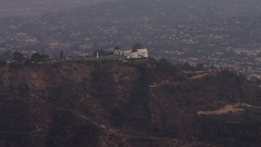 5K stock footage aerial video approach the Griffith Observatory at twilight, Los Angeles, California Aerial Stock Footage | AX64_0169