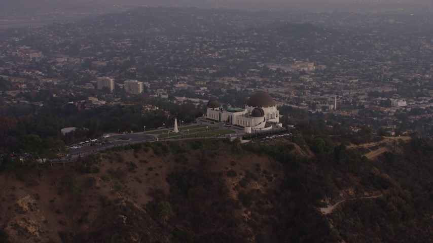 5K stock footage aerial video approach and flyby the Griffith Observatory, Los Angeles, California, twilight Aerial Stock Footage | AX64_0170