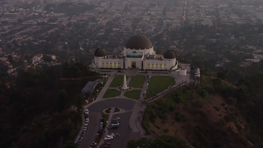 5K stock footage aerial video flyby the north side of Griffith Observatory, Los Angeles, California, twilight Aerial Stock Footage | AX64_0171