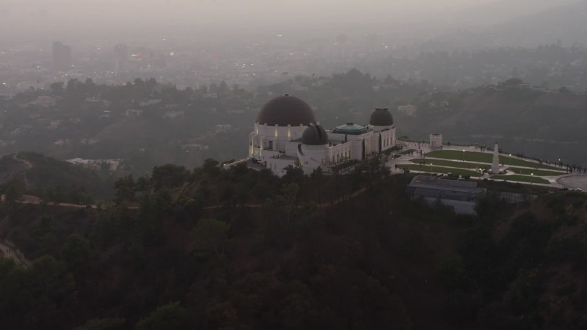 5K stock footage aerial video flyby the east side of the Griffith Observatory, Los Angeles, California, twilight Aerial Stock Footage | AX64_0172
