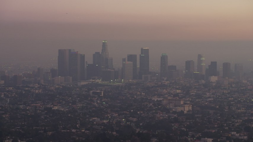 Downtown los angeles skyline in haze california sunset aerial the downtown los angeles skyline in haze california sunset aerial stock footage ax640176 sciox Gallery