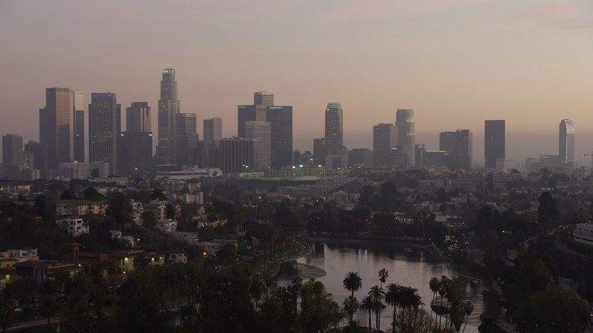 5K stock footage aerial video of Downtown Los Angeles in haze and Echo Lake at twilight, California Aerial Stock Footage | AX64_0182