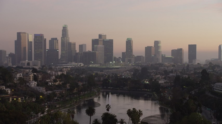 5K aerial video fly over Echo Lake to approach Downtown Los Angeles at twilight, California Aerial Stock Footage | AX64_0183