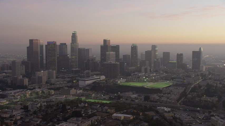 5K stock footage aerial video flyby the Downtown Los Angeles skyline at twilight, California Aerial Stock Footage | AX64_0186