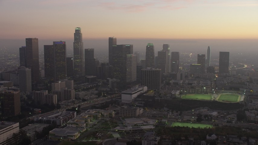5K stock footage aerial video of Downtown Los Angeles skyline and heavy traffic on the 110 freeway in California, twilight Aerial Stock Footage | AX64_0187