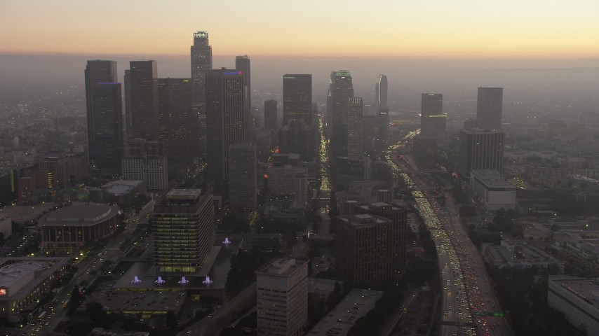 5K stock footage aerial video of Downtown Los Angeles skyline and heavy traffic on the 110 freeway, California, twilight Aerial Stock Footage | AX64_0188