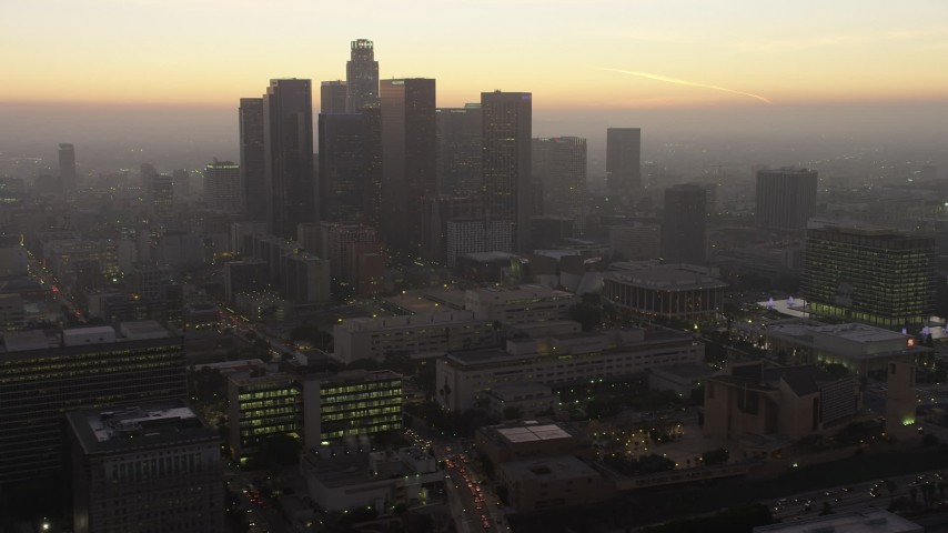 5K aerial video flyby the Downtown Los Angeles skyline to reveal City Hall, California, twilight Aerial Stock Footage | AX64_0190