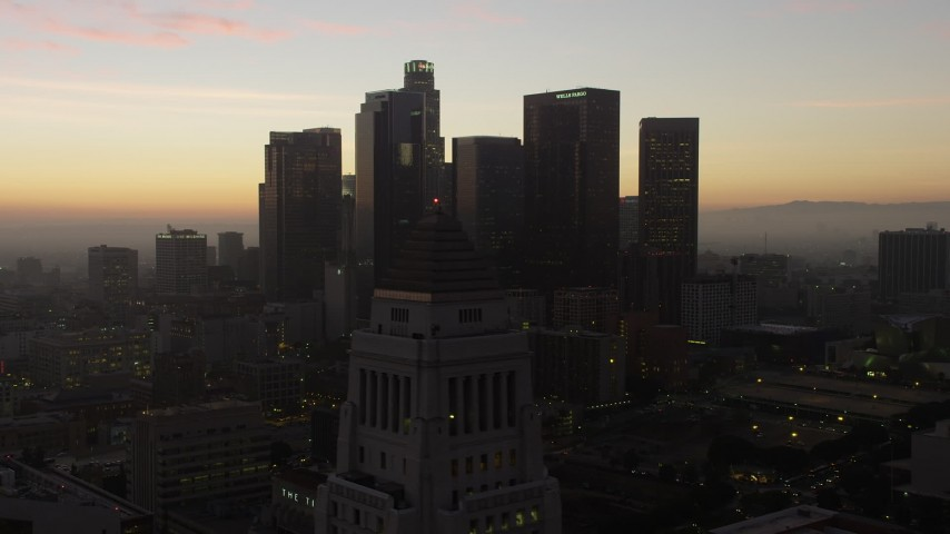 5K aerial video flyby the top of City Hall for a view of Downtown Los Angeles skyline, California, twilight Aerial Stock Footage | AX64_0192