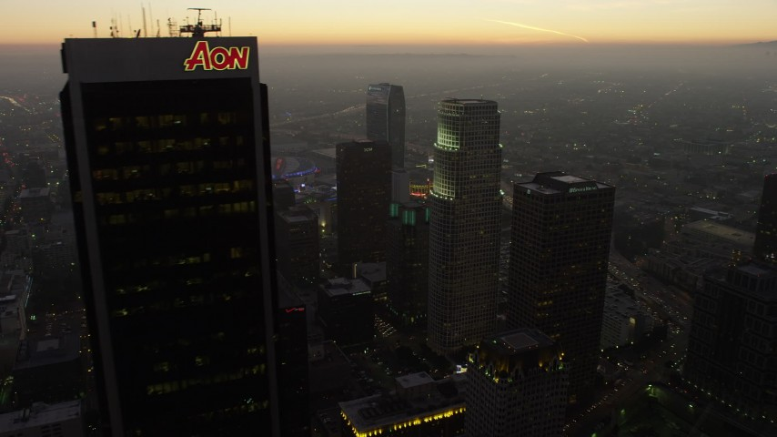 5K stock footage aerial video flyby Aon Center to reveal skyscrapers and Staples Center in Downtown Los Angeles, California, twilight Aerial Stock Footage | AX64_0196