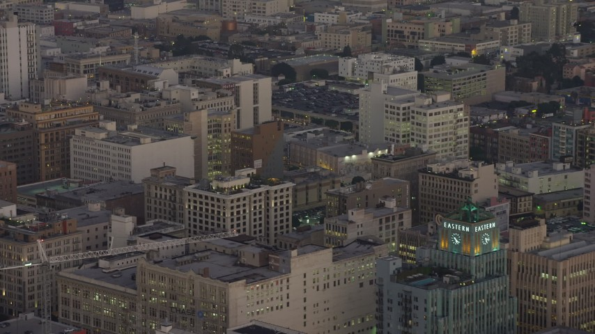 5K stock footage aerial video of office buildings in Downtown Los Angeles, California, twilight Aerial Stock Footage | AX64_0201
