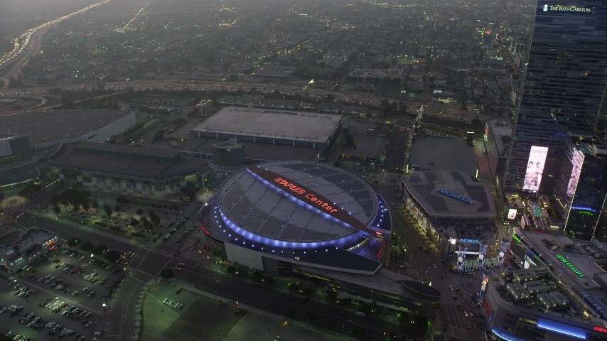 5K stock footage aerial video of Staples Center arena and The Ritz-Carlton hotel, Downtown Los Angeles, California, twilight Aerial Stock Footage | AX64_0204