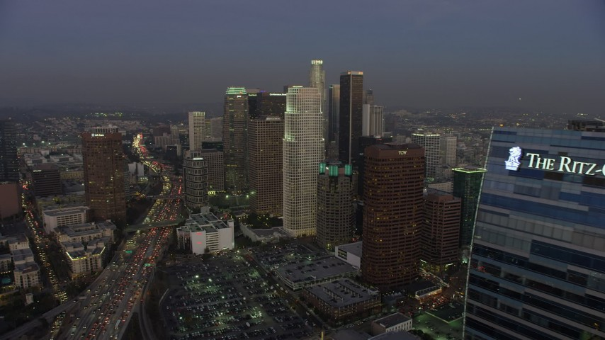 5K stock footage aerial video flyby Ritz-Carlton hotel to reveal Downtown Los Angeles skyscrapers, California, twilight Aerial Stock Footage | AX64_0205