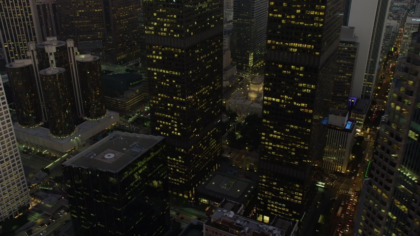 5K stock footage aerial video flyby skyscrapers to reveal the public library and 5th Street in Downtown Los Angeles, California, twilight Aerial Stock Footage | AX64_0208