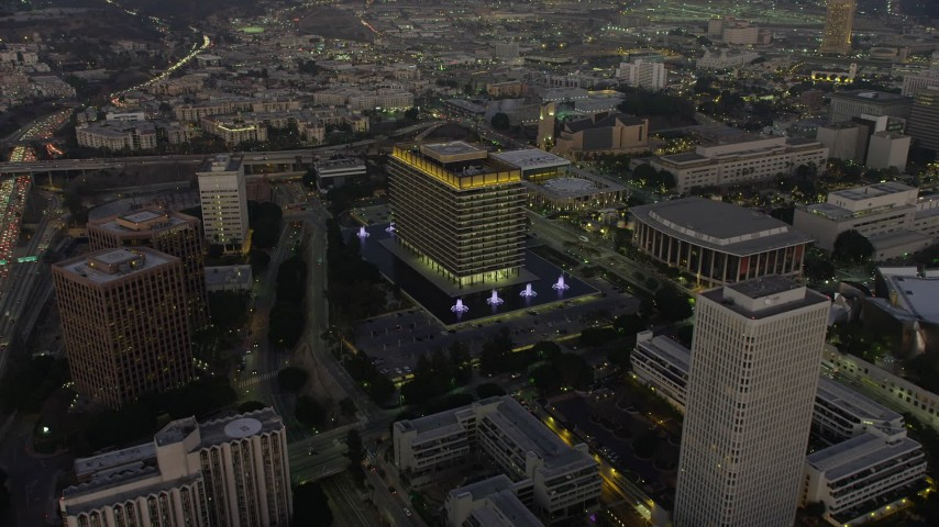 5K stock footage aerial video of LADWP office building and concert halls, Downtown Los Angeles, California, twilight Aerial Stock Footage | AX64_0210