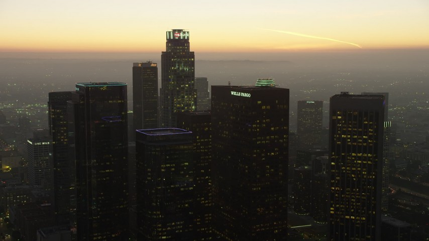 5K stock footage aerial video of US Bank Tower and skyscrapers, Downtown Los Angeles, California, twilight Aerial Stock Footage | AX64_0212