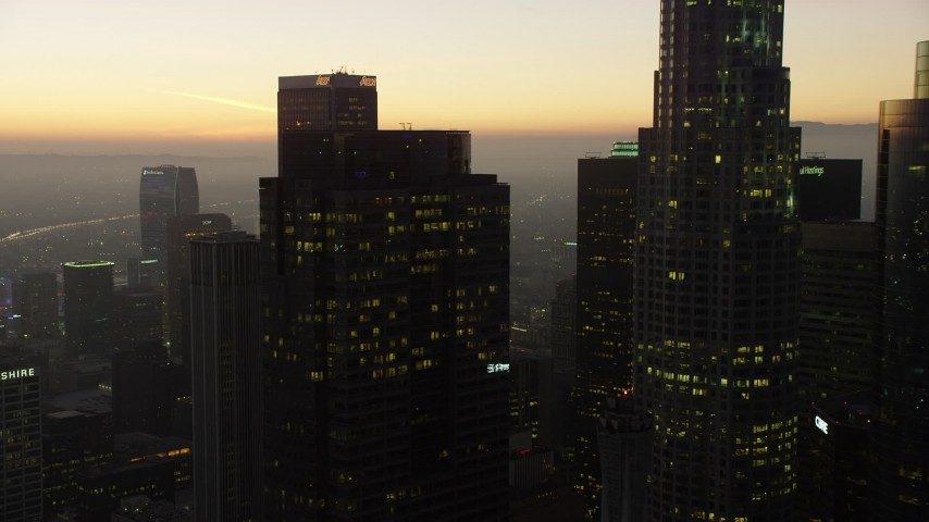 5K stock footage aerial video flyby Gas Company Tower and 611 Place in Downtown Los Angeles, California, twilight Aerial Stock Footage | AX64_0214