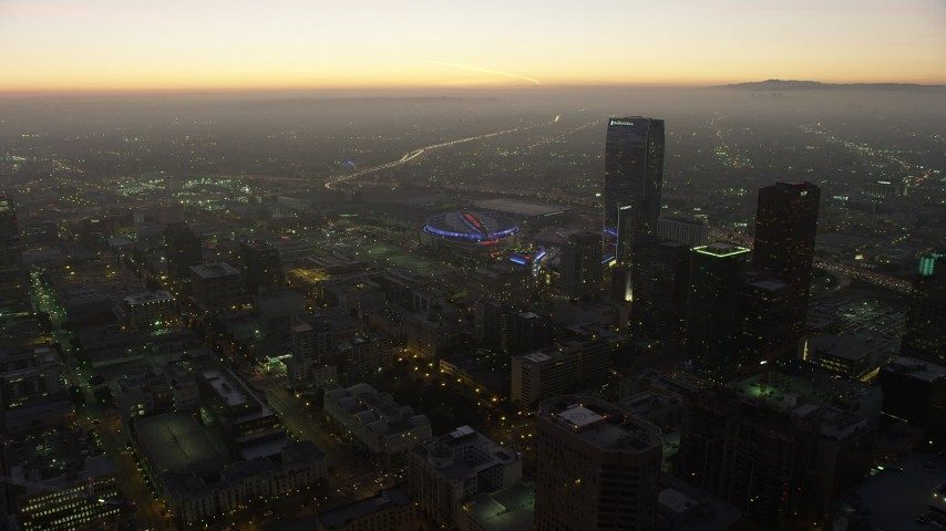 5K stock footage aerial video of Staples Center arena and The Ritz-Carlton hotel, Downtown Los Angeles, California, twilight Aerial Stock Footage | AX64_0216
