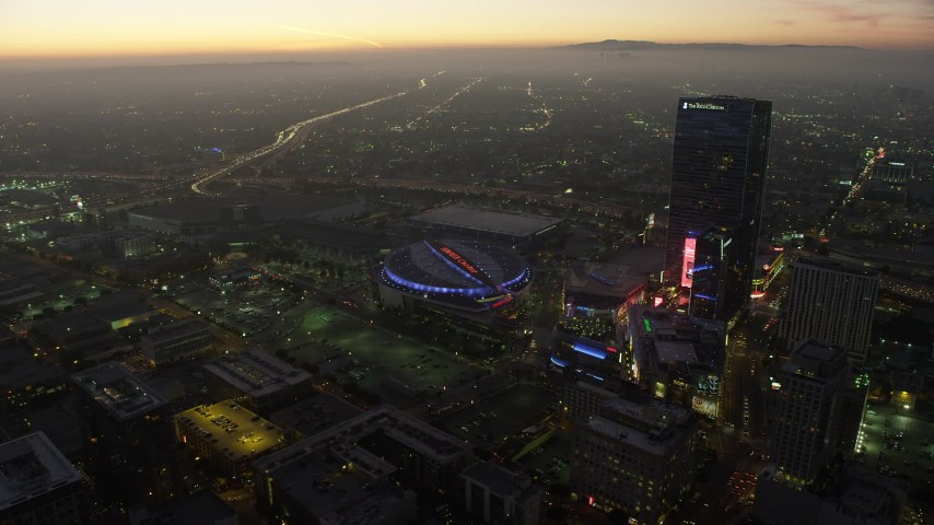 5K stock footage aerial video of Staples Center arena, Nokia Theater, and The Ritz-Carlton in Downtown Los Angeles, California, twilight Aerial Stock Footage | AX64_0217