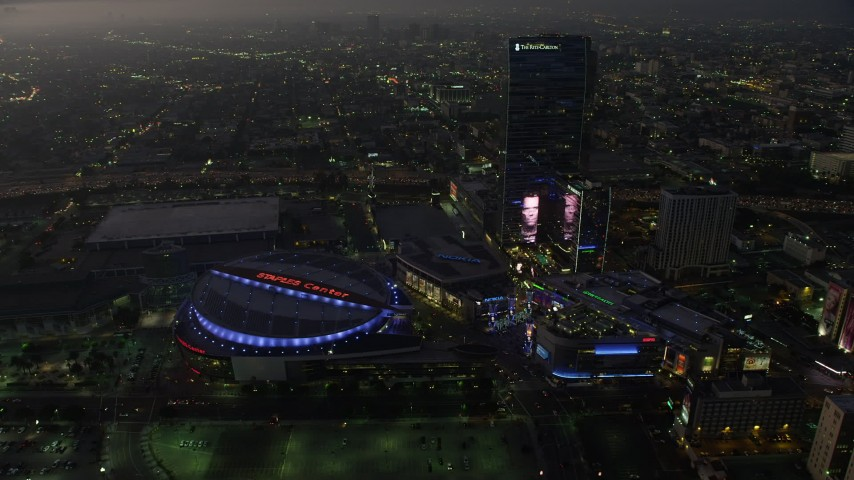 5K stock footage aerial video flyby Staples Center arena, Nokia Theater, and The Ritz-Carlton, Downtown Los Angeles, California, twilight Aerial Stock Footage AX64_0218 | Axiom Images