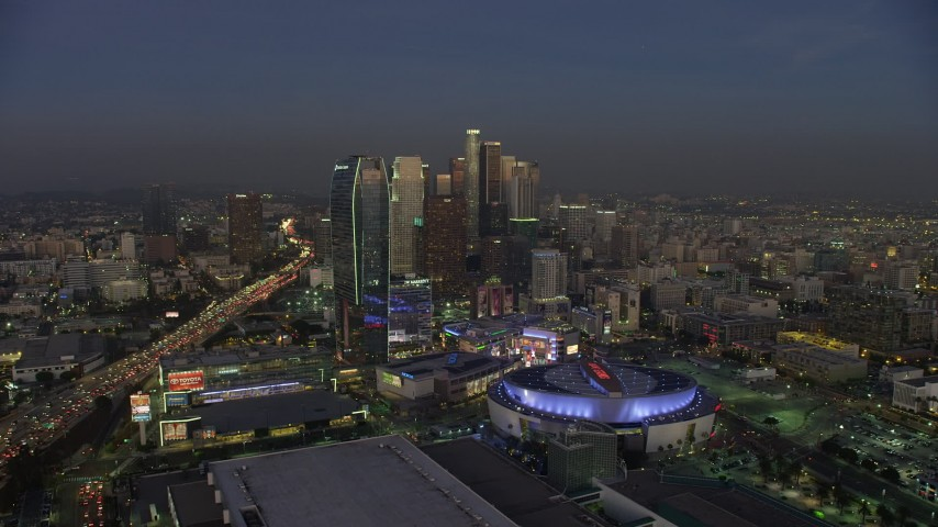 5K stock footage aerial video of Staples Center, Nokia Theater, Ritz-Carlton hotel, and Downtown Los Angeles skyscrapers, California, twilight Aerial Stock Footage | AX64_0222